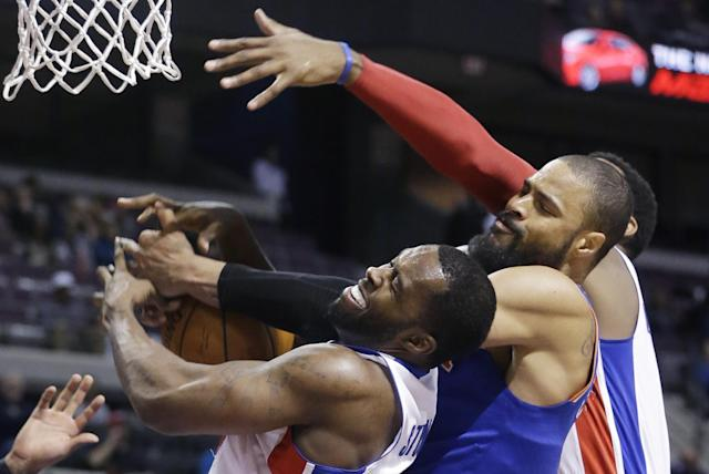 Detroit Pistons guard Rodney Stuckey, left, New York Knicks center Tyson Chandler, center, and Detroit Pistons center Andre Drummond battle for the rebound during the second half of an NBA basketball game in Auburn Hills, Mich., Monday, March 3, 2014. (AP Photo/Carlos Osorio)