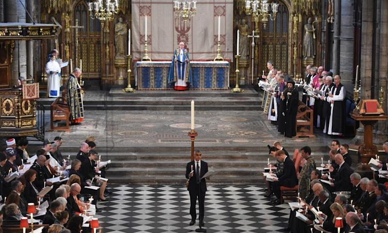 London's mayor Sadiq Khan takes part in the service at Westminster Abbey.
