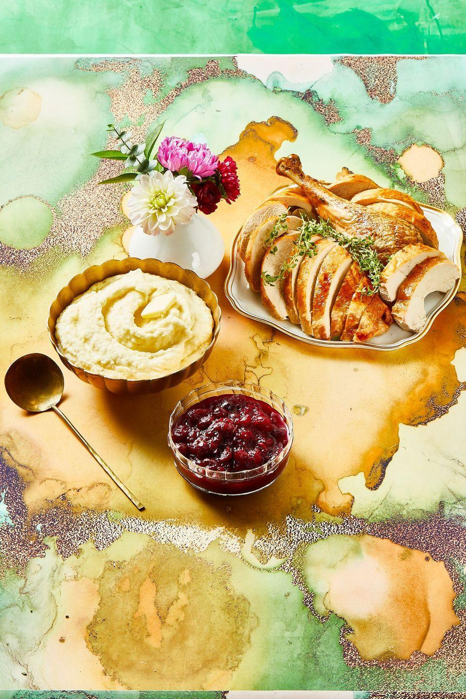 """<p>Fresh apples lend sweetness (and festive fall flavor), while the orange zest and juice keep it tangy.</p><p><strong><em><a href=""""https://www.womansday.com/food-recipes/a34128863/apple-orange-cranberry-sauce-recipe/"""" rel=""""nofollow noopener"""" target=""""_blank"""" data-ylk=""""slk:Get the Apple-Orange Cranberry Sauce recipe."""" class=""""link rapid-noclick-resp"""">Get the Apple-Orange Cranberry Sauce recipe. </a></em></strong></p>"""