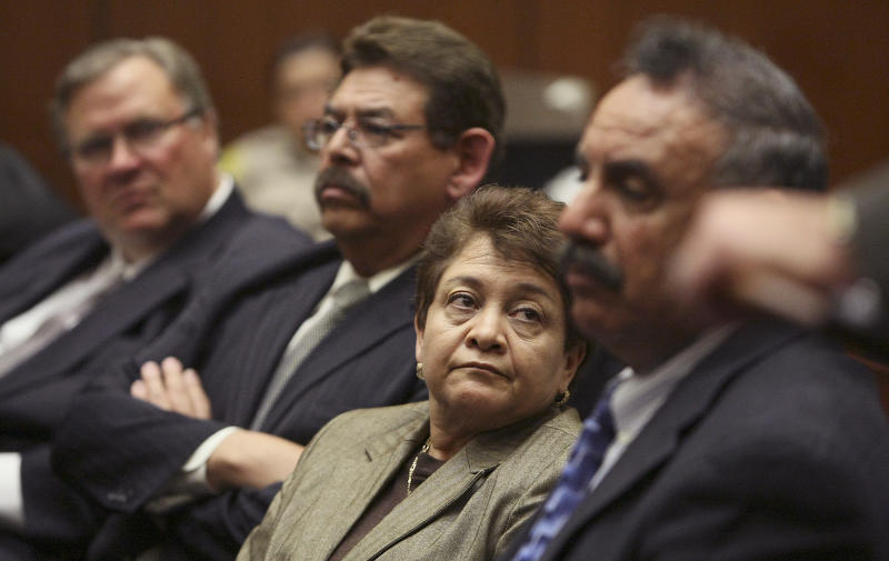 Current and former Bell city council members from left, George Cole, George Mirabal, Teresa Jacobo and mayor Oscar Hernandez and listen during a preliminary hearing  in Los Angeles Superior Court on Wednesday Feb. 16 2011.   Superior Court Judge Henry Hall ordered the six to trial following a preliminary hearing.   Mayor Oscar Hernandez and former council members Luis Artiga, Victor Bello, George Cole, Teresa Jacobo and George Mirabel also were ordered to stay away from City Hall and no longer participate in Bell's civic affairs.   Each made about $100,000 a year for service on a City Council that meets once a month and other agencies.   (AP Photo/Brian van der Brug, Pool)