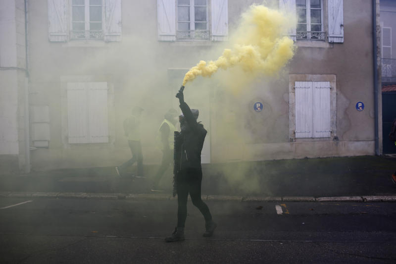 The Latest: French protesters demand more help from govt
