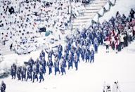 <p>To keep warm in Norway's Lysgårdsbakken Ski Jump Arena, Team USA arrived in full blue snowsuits, including thickly knit scarves, plenty of stars and stripes, and grey cowboy hats. </p>