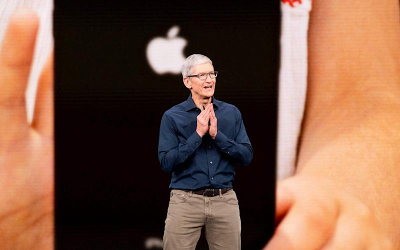 Tim Cook unveiling the new iPhones last week - AFP