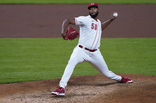 Cincinnati Reds relief pitcher Amir Garrett throws during the ninth inning of the team's baseball game against the Pittsburgh Pirates in Cincinnati, Tuesday, Sept. 15, 2020. (AP Photo/Bryan Woolston)
