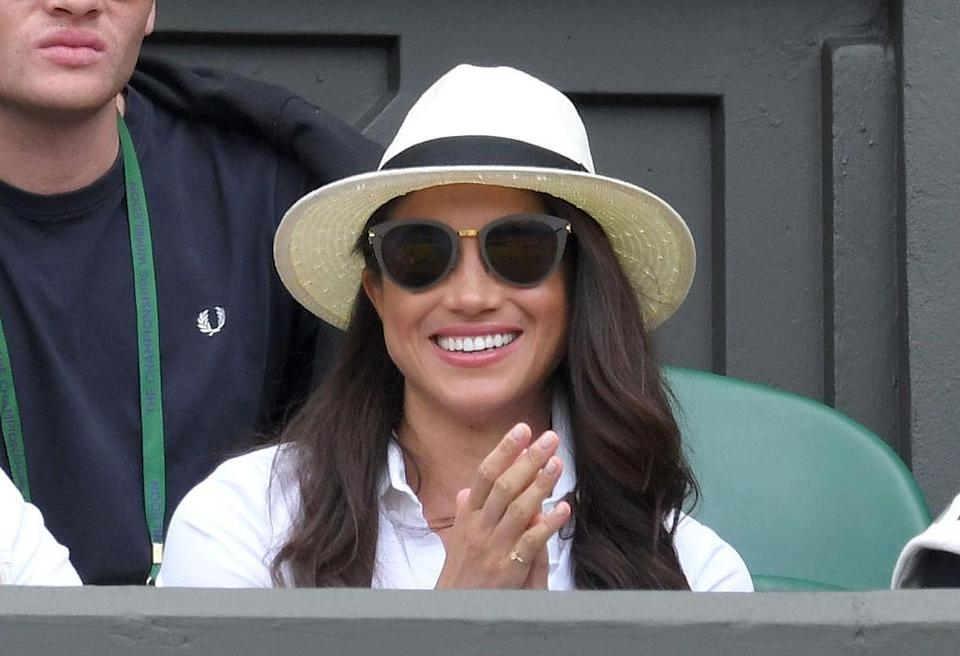<p>Meghan wears a panama hat from Madewell x Biltmore at the 2016 Wimbledon championships in London. (Photo: Karwai Tang/WireImage) </p>