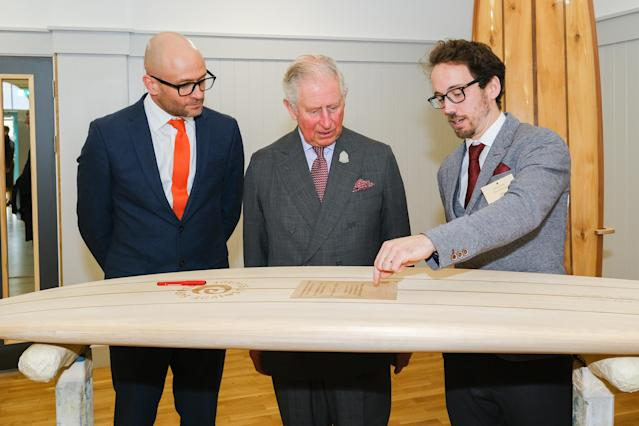 The Prince of Wales with James Otter (right) as he becomes the patron of Surfers Against Sewage. (Press Association)