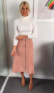 """<p>Holly teamed a blush-hued suede <a rel=""""nofollow noopener"""" href=""""https://www.lkbennett.com/product/CSRIALEATHERPinkBlush~Ria-Leather-Skirt-Blush?gclid=EAIaIQobChMIqaypjpOg1wIVybztCh3kHAKxEAYYASABEgK92PD_BwE"""" target=""""_blank"""" data-ylk=""""slk:skirt"""" class=""""link rapid-noclick-resp"""">skirt</a> by LK Bennett with a cream knit by Marks and Spencer. </p>"""