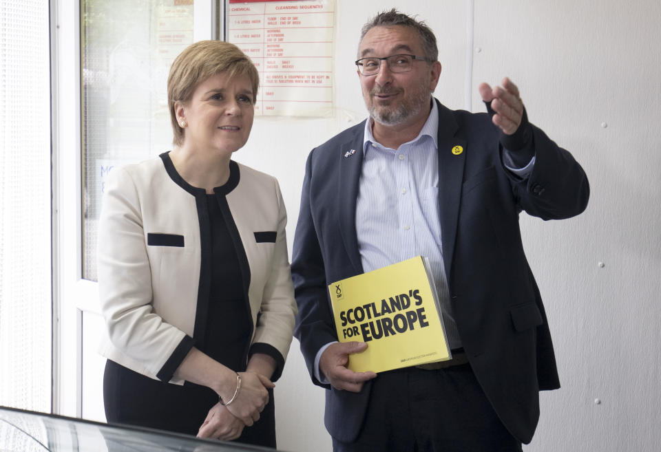 First Minister Nicola Sturgeon with SNP European election candidate Christian Allard during a visit to J Charles Ltd seafood processing plant in Aberdeen. Christian Allard worked at J Charles Ltd for 25 years exporting seafood to the continent, before he entered politics.