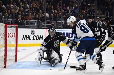 Mar 18, 2019; Los Angeles, CA, USA; Winnipeg Jets left wing Kyle Connor (81) shoots the puck past Los Angeles Kings goaltender Jack Campbell (36) for a goal  in the first period at Staples Center. Mandatory Credit: Kirby Lee-USA TODAY Sports