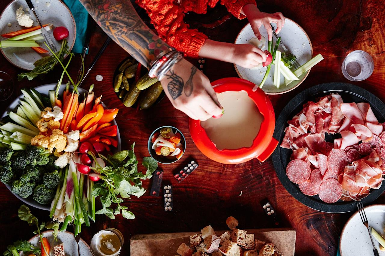 """When just Bourbon isn't enough, add beer. Babybel cheese keeps the molten mixture from separating, and its unassuming flavor lets the Gruyère shine. <a href=""""https://www.epicurious.com/recipes/food/views/cheese-fondue-with-beer-and-bourbon?mbid=synd_yahoo_rss"""">See recipe.</a>"""