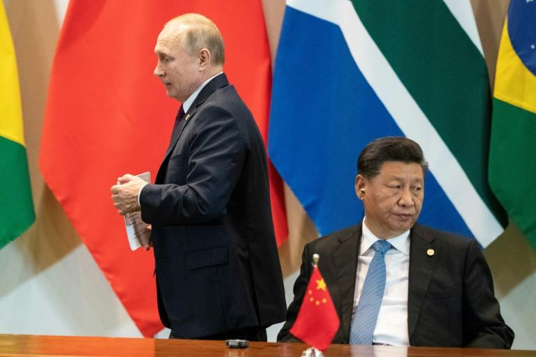 """China's President Xi Jinping (R) has called Putin his """"best friend"""""""