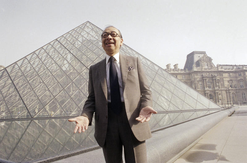 FILE - In this March 29, 1989, file photo, Chinese-American architect I.M. Pei laughs while posing for a portrait in front of the Louvre glass pyramid, which he designed, in the museum's Napoleon Courtyard, prior to its inauguration in Paris. Pei, the globe-trotting architect who revived the Louvre museum in Paris with a giant glass pyramid and captured the spirit of rebellion at the multi-shaped Rock and Roll Hall of Fame, has died at age 102, a spokesman confirmed Thursday, May 16, 2019. (AP Photo/Pierre Gleizes, File)