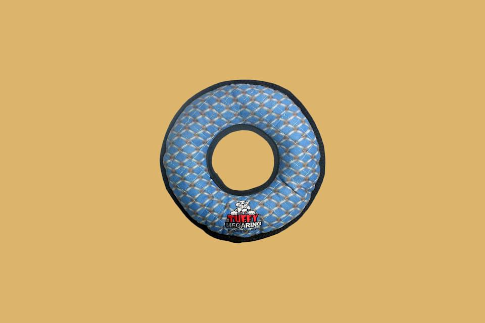 """<p>The only thing better than a durable disc for playing fetch is one with built-in squeakers. Composed of seven layers of materials and multiple rows of stitching that make it harder to chew through, this ring-shaped squeaky toy is light enough to float on water but tough enough for a big dog to play with.</p> <p><strong><em>Shop Now: </em></strong><em>Tuffy Mega Ring Dog Toy in Blue, $23.52</em><em>, <a href=""""https://www.anrdoezrs.net/links/9104911/type/dlg/sid/MSL11oftheBestToysforBigDogsrhaarsDogGal7987422202009I/https://www.bedbathandbeyond.com/store/product/tuffy-mega-ring-dog-toy/5330901"""" rel=""""nofollow noopener"""" target=""""_blank"""" data-ylk=""""slk:bedbathandbeyond.com"""" class=""""link rapid-noclick-resp"""">bedbathandbeyond.com</a></em><em>.</em></p>"""