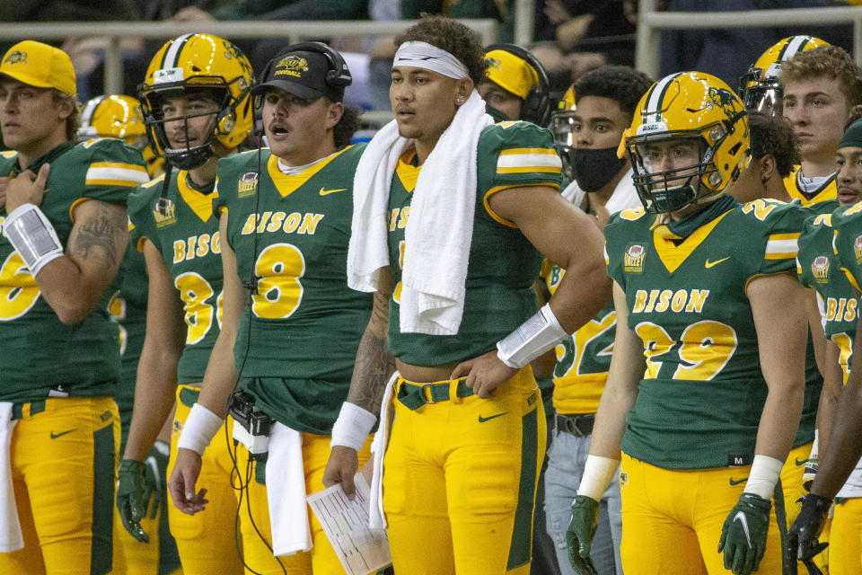 North Dakota State quarterback Zeb Noland (8), quarterback Trey Lance, with towel, and running back Dominic Gonnella (29) watch as their team plays Central Arkansas at an NCAA college football game Saturday, Oct. 3, 2020, in Fargo, N.D. North Dakota State won 39-28. (AP Photo/Bruce Kluckhohn)