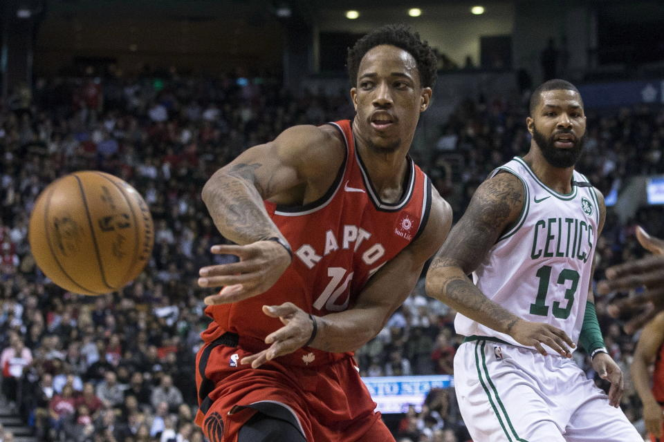 DeMar DeRozan passes the ball in front of the Celtics' Marcus Morris during the second half Tuesday night. (AP)