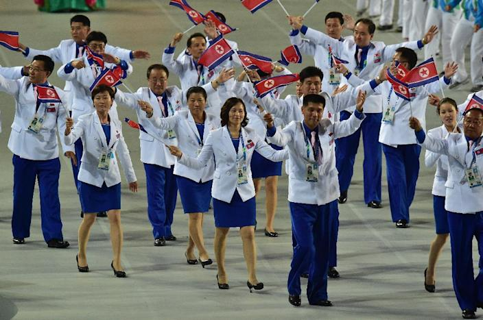 North Korean athletes are seen during the opening ceremony of the 2014 Asian Games, at the Incheon Asiad Main Stadium, South Korea, on September 19, 2014 (AFP Photo/Jung Yeon-Je)