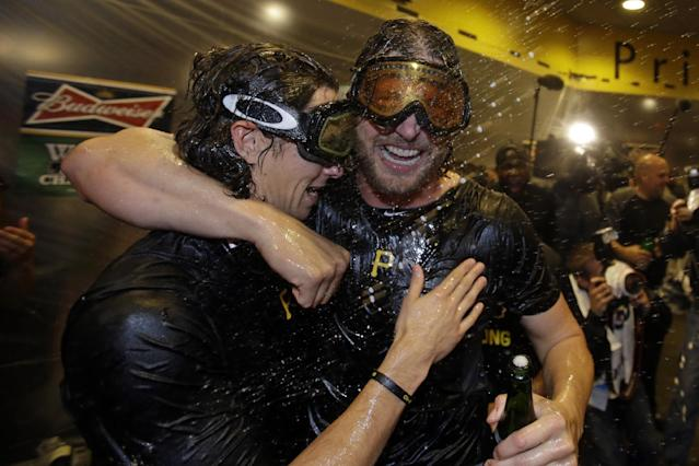 Pittsburgh Pirates pitchers Jason Grilli, right, and Jeff Locke celebrate after beating the Cincinnati Reds in the National League Wild-Card playoff baseball game, 6-2, in Pittsburgh Tuesday, Oct. 1, 2013. The Pirates advance to the NLDS playoff series against the St,. Louis Cardinals. (AP Photo/Gene J. Puskar)