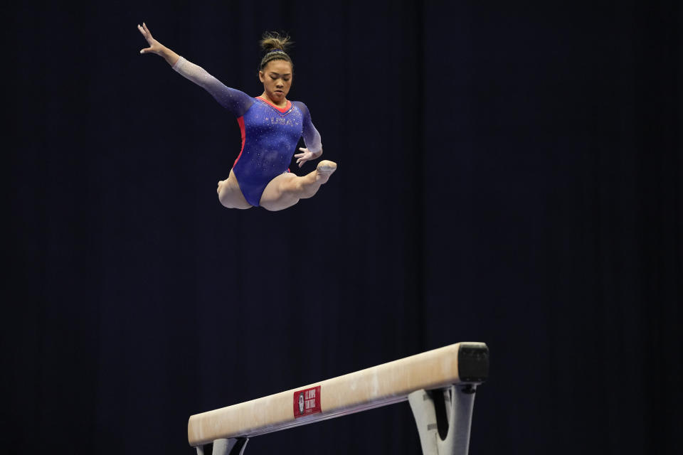 Suni Lee competes on the balance beam during the women's U.S. Olympic Gymnastics Trials Friday, June 25, 2021, in St. Louis. (AP Photo/Jeff Roberson)