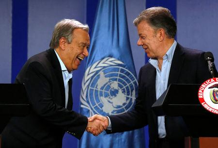 Colombia's President Juan Manuel Santos and U.N. Secretary General Antonio Guterres shake hands during a joint news conference in Bogota