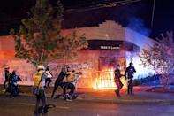 PHOTO: Portland police disperse a crowd after protesters set fire to the Portland Police Association (PPA) building early in the morning on Aug. 29, 2020 in Portland, Ore. (Nathan Howard/Getty Images, FILE)