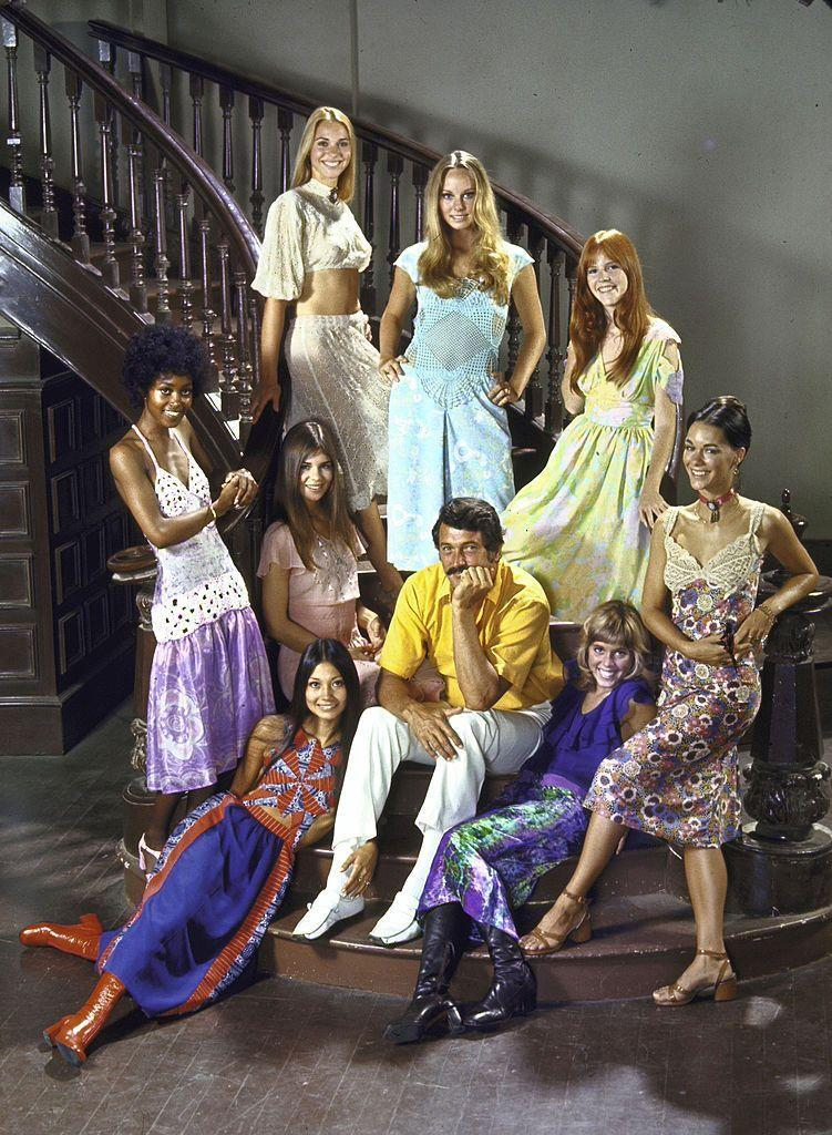 <p>On the MGM lot, Hudson sat surrounded by his female costars from the film, <em>Pretty Maids All in a Row</em>. </p>