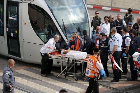Israeli medics evacuate a wounded Palestinian minor, who police said stabbed an Israeli security guard, in Pisgat Zeev, which lies on occupied land that Israel annexed to Jerusalem after the 1967 Middle East war, November 10, 2015. REUTERS/Ammar Awad