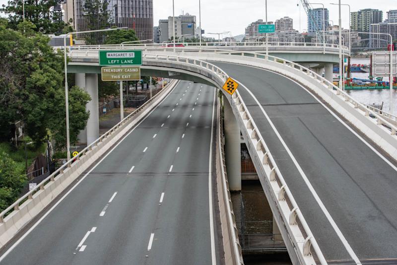 A view of a deserted Coronation Drive in Brisbane.
