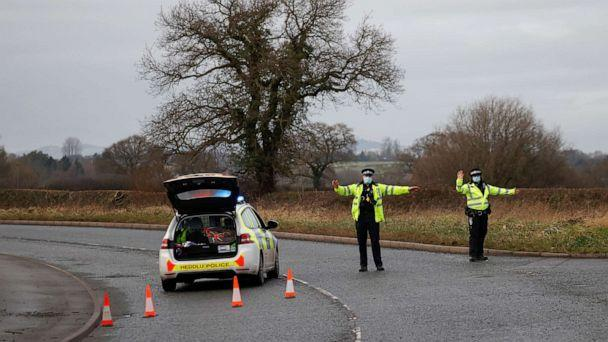 PHOTO: Police officers manage a checkpoint on a road near the Wockhardt pharmaceutical plant in Wrexham, Britain January 27, 2021. (Phil Noble/Reuters)
