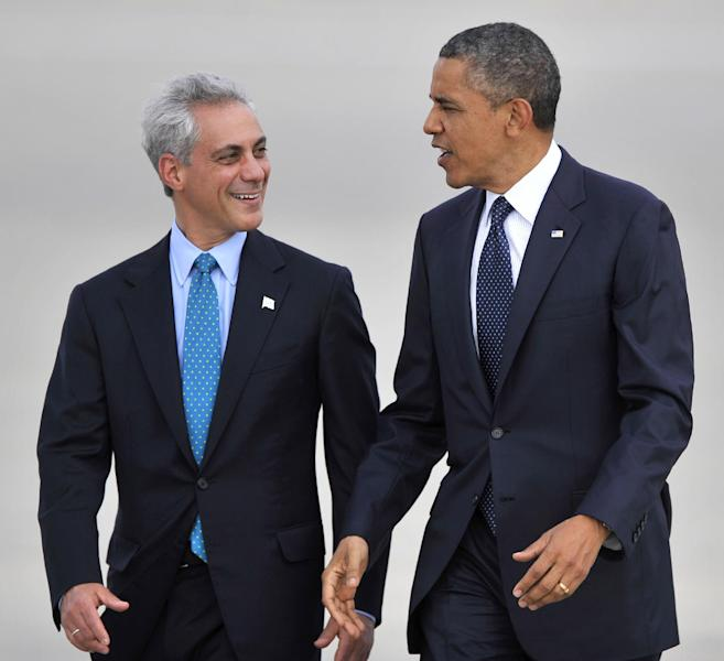 President Barack Obama right, talks with Chicago Mayor Rahm Emanuel left, as he walks off Air Force One after arriving at O'Hare International Airport in Chicago, Wednesday, May 29, 2013. (AP Photo/Paul Beaty)
