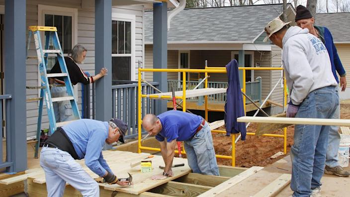 ASHEVILLE, NORTH CAROLINA, USA - APRIL 3, 2008: Volunteers for the nonprofit organization Habitat for Humanity work building new energy efficient houses for low income partner families in Asheville.