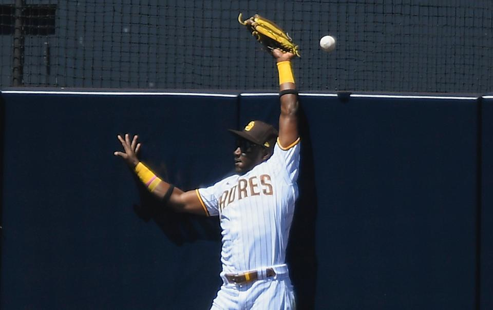 SAN DIEGO, CA - APRIL 7:  Jorge Mateo #3 of the San Diego Padres can't make the catch on home run hit by Darin Ruf #33 of the San Francisco Giants during the second inning of a baseball game at Petco Park on April 7, 2021 in San Diego, California.  (Photo by Denis Poroy/Getty Images)