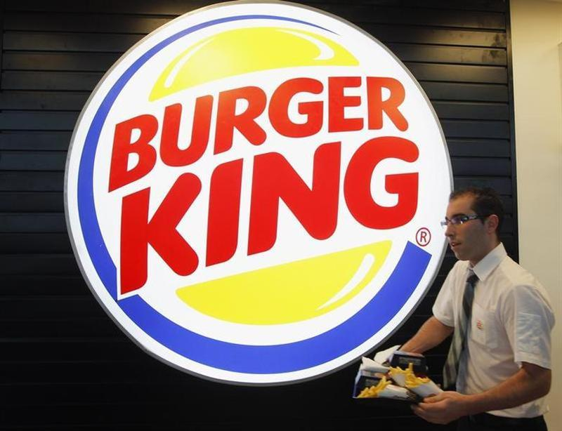 An employee prepares a food order on the opening day of the Burger King restaurant at the Marignane airport hall