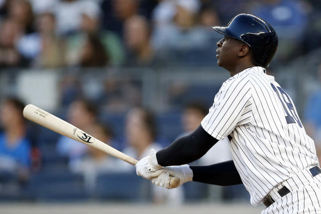 New York Yankees' Didi Gregorius watches his solo home run during the third inning of a baseball game against the Tampa Bay Rays, Friday, June 15, 2018, in New York. (AP Photo/Adam Hunger)