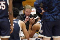 FILE - In this Feb. 4, 2021, file photo, Gonzaga coach Mark Few huddles with his team during a timeout in the second half of an NCAA college basketball game against Pacific in Stockton, Calif. Few isn't being asked questions about where his team should be seeded for next month's NCAA Men's Basketball Tournament. Instead, the longtime coach is getting a different question with a little more than a month until Selection Sunday — does it make any sense for Gonzaga to compete in its conference tournament? (AP Photo/Rich Pedroncelli, File)