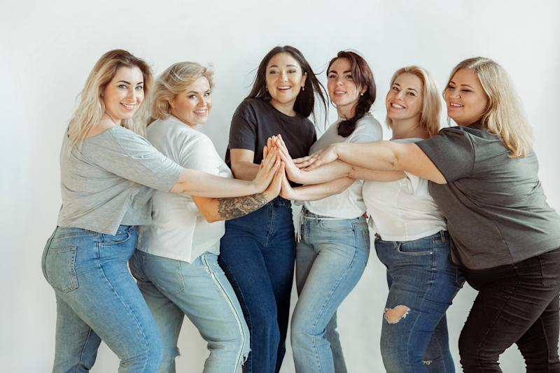 Young caucasian women in casual clothes having fun together. Friends posing on white background and laughting, looks happy, well-kept. Bodypositive, feminism, loving themself, beauty concept.