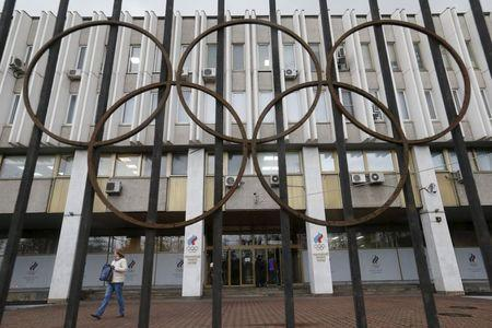 A woman walks out of the Russian Olympic Committee headquarters building, which also houses the management of Russian Athletics Federation in Moscow, Russia, November 13, 2015. REUTERS/Maxim Zmeyev