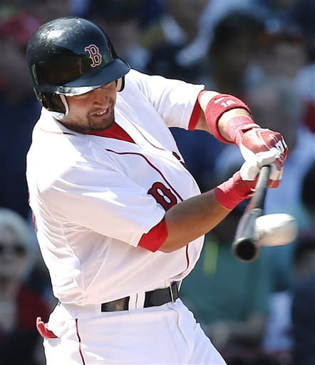 Boston Red Sox's Shane Victorino connects but lines out to third during the first inning of a baseball game against the Baltimore Orioles at Fenway Park in Boston Monday, April 8, 2013. (AP Photo/Winslow Townson)
