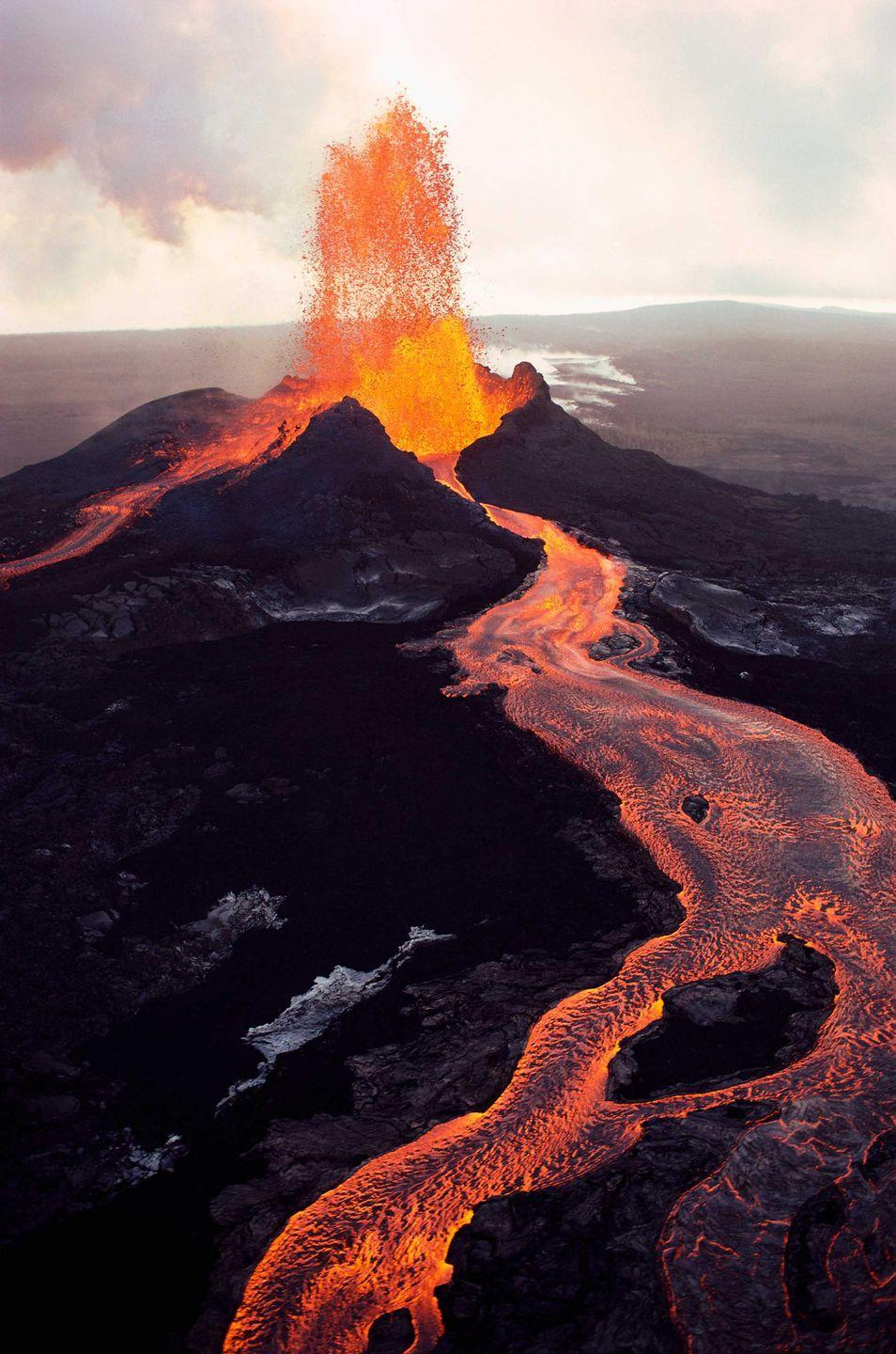 """<p>It's not just <em>anywhere</em> visitors can get up close to an active volcano like Kilauea Volcano, situated in <a href=""""https://www.nps.gov/havo/index.htm"""" rel=""""nofollow noopener"""" target=""""_blank"""" data-ylk=""""slk:Hawaii Volcanoes National Park"""" class=""""link rapid-noclick-resp"""">Hawaii Volcanoes National Park</a>. A dream for hikers across this 500 square miles of terrain, you'll see anything from lush <a href=""""https://www.bestproducts.com/fun-things-to-do/g25381127/beautiful-costa-rica-resorts/"""" rel=""""nofollow noopener"""" target=""""_blank"""" data-ylk=""""slk:tropical rainforests"""" class=""""link rapid-noclick-resp"""">tropical rainforests</a> to desert and of course, active volcanoes. Before you visit, make sure to check if there are any closures due to volcanic activity.<br> </p>"""