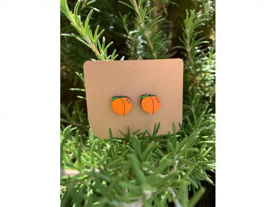 Not all emoji-themed gifts need to be neon yellow, these peach earrings are playful and subtle (Etsy)