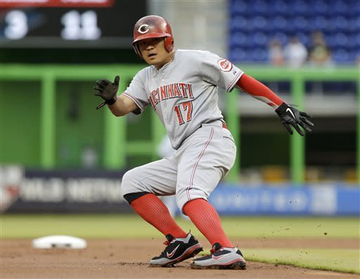 Cincinnati Reds' Shin-Soo Choo stops as he prepares to head back to second base on a fly ball by Joey Votto in the first inning of a baseball game against the Miami Marlins in Miami, Wednesday, May 15, 2013. (AP Photo/Alan Diaz)
