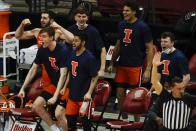 The Illinois bench reacts after a basket during the second half of an NCAA college basketball game against the Wisconsin Saturday, Feb. 27, 2021, in Madison, Wis. (AP Photo/Morry Gash)