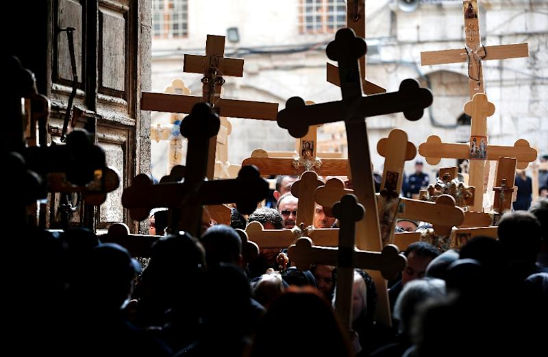 Christian pilgrims enter the Holy Sepulchre Church during a 2015 ceremony in Jerusalem's Old City