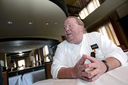 Celebrity chef Mario Batali talks during an interview with Reuters at his restaurant, Del Posto, in New York, U.S., April 11, 2006.  REUTERS/Brendan McDermid/File Photo