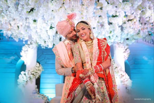 The stunning couple had a dreamy wedding on February 15th, 2019. Pictures from the ceremony show a glowing bride surrounded by her loved ones, with pre-wedding festivities bringing the families together. Her wedding ensemble brought back memories of the coy Anushka Sharma who tied the knot wearing a pink Sabyasachi <em>lehenga </em>embellished with floral embroidery all over. Unfortunately, they had to postpone their reception, owing to the ill-health of Neeti's father.