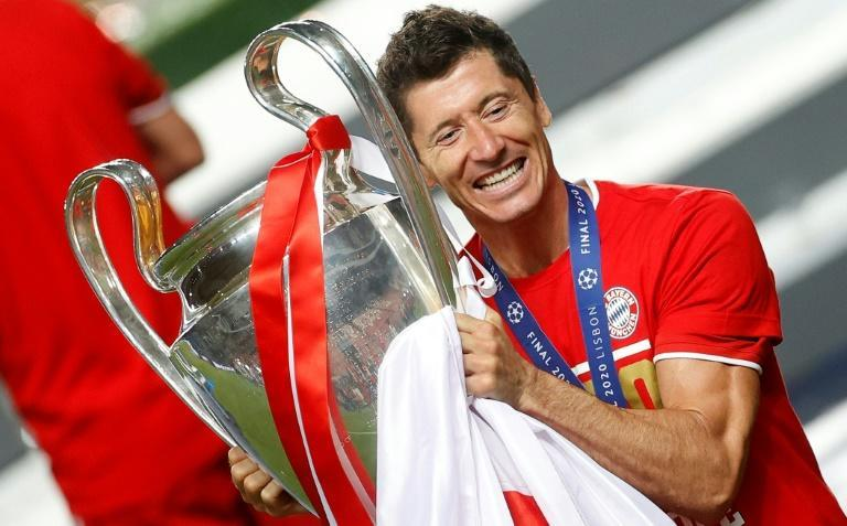 Robert Lewandowski poses with the Champions League trophy after a 1-0 win over Paris Saint Germain in the 2019/20 final