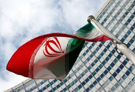 An Iranian flag flutters in front of the United Nations headquarters, during an IAEA board of governors meeting, in Vienna