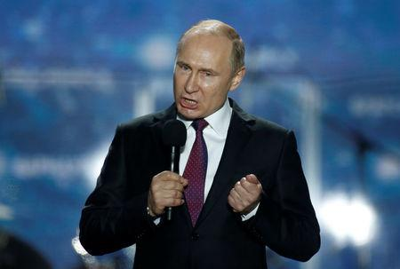 Russian president Vladimir Putin addresses the audience during a rally marking the fourth anniversary of Russia's annexation of Ukraine's Crimea region in the Black Sea port of Sevastopol, Crimea, March 14, 2018. REUTERS/Maxim Shemetov