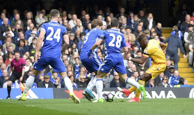 <p>Crystal Palace's Wilfried Zaha scores their first goal </p>