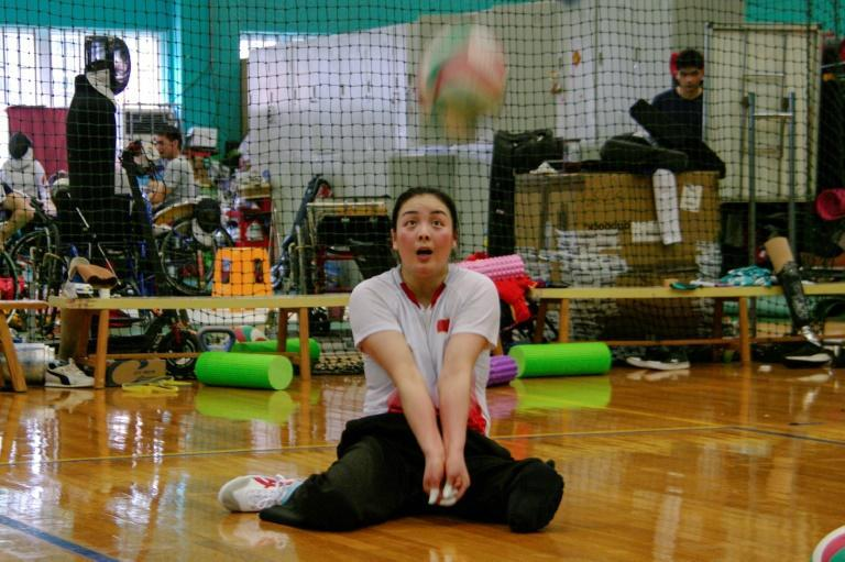 Tang Xuemei is a Paralympic gold-medallist in sitting volleyball