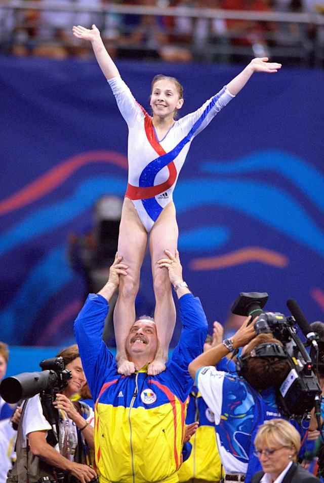 21 Sep 2000: Andreea Raducan of Romania celebrates gold in the Womens Gymnastics Individual All Around Final at the Sydney Superdome on Day Six of the Sydney 2000 Olympic Games in Sydney, Australia. \ Mandatory Credit: Ezra Shaw /Allsport